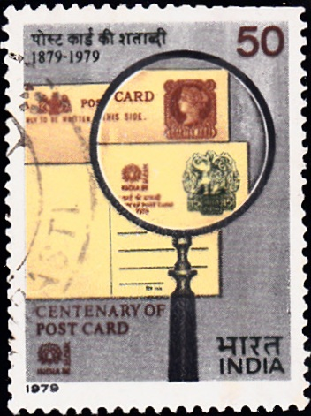 Post Cards of 1/4 anna (1879) & 15 paisa (1979) under Magnifying Glass